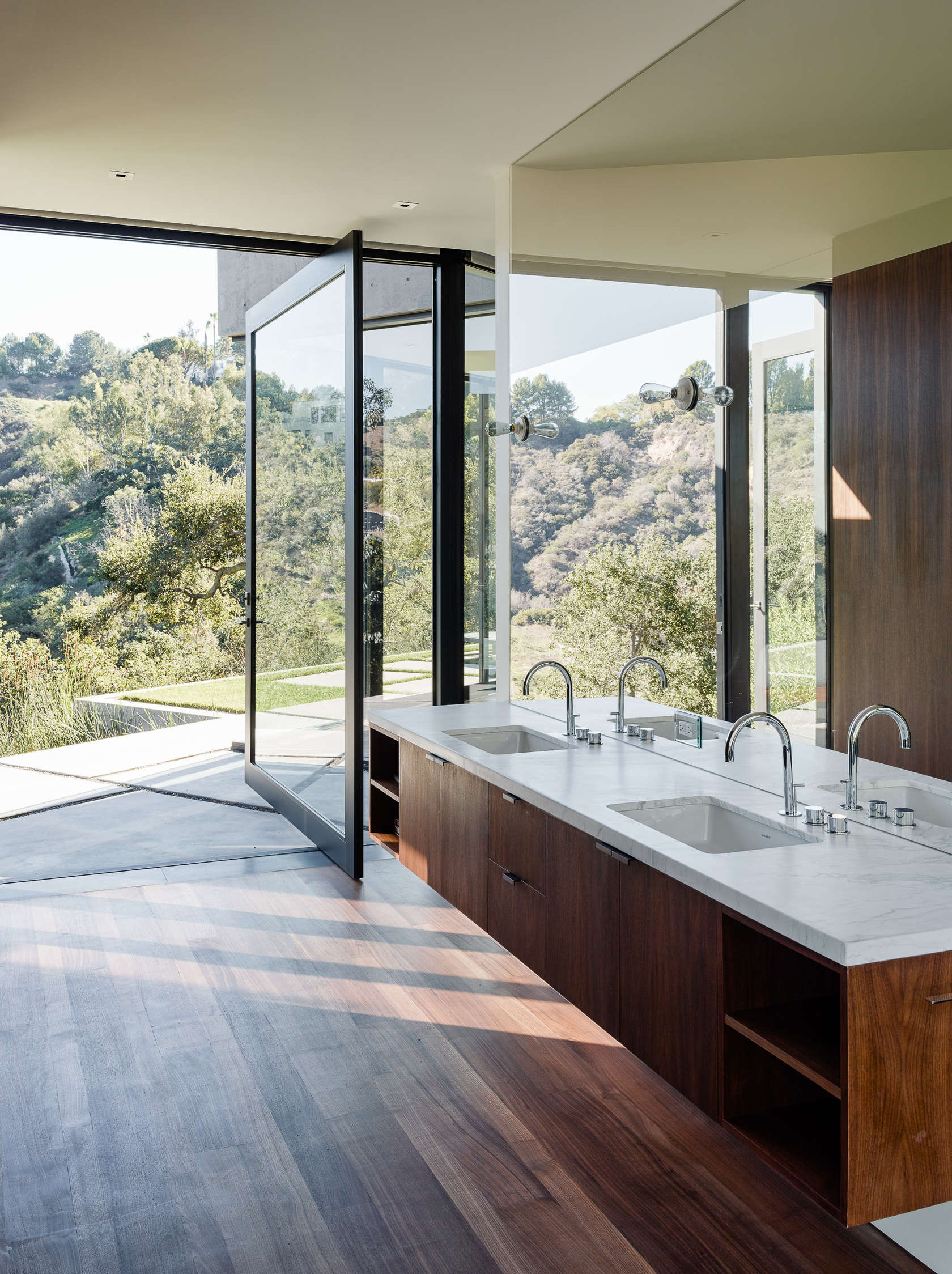 Modern Wood Bathroom - An upside down beverly hills home with a minimalist exterior