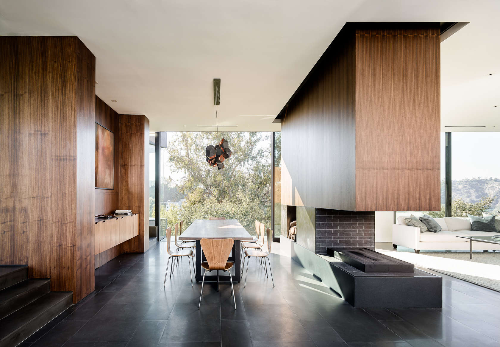 Open Floorplan Dining Room - An upside down beverly hills home with a minimalist exterior
