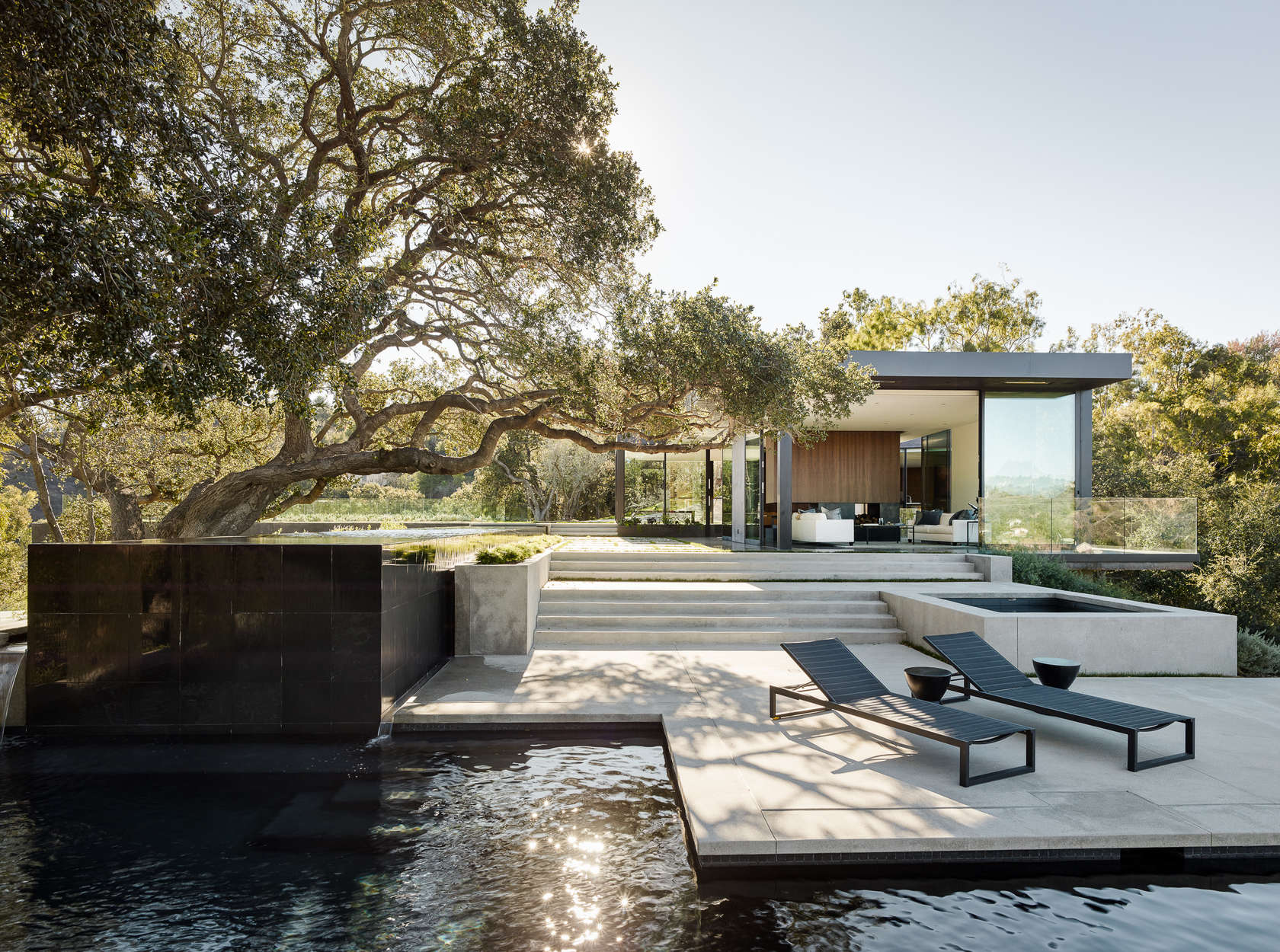 Outdoor Deck Design - An upside down beverly hills home with a minimalist exterior