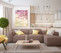 The second home is not all that different from the first. Muted browns and silky yellows are once again used in concert for what becomes a natural and almost celebratory palette. An indoor tree in this home manages to extend the early elements of the design.