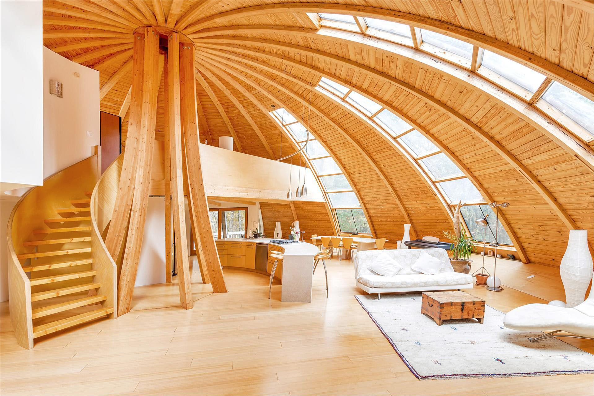 Flying saucer shaped house takes design to new heights for Interior design styles wood