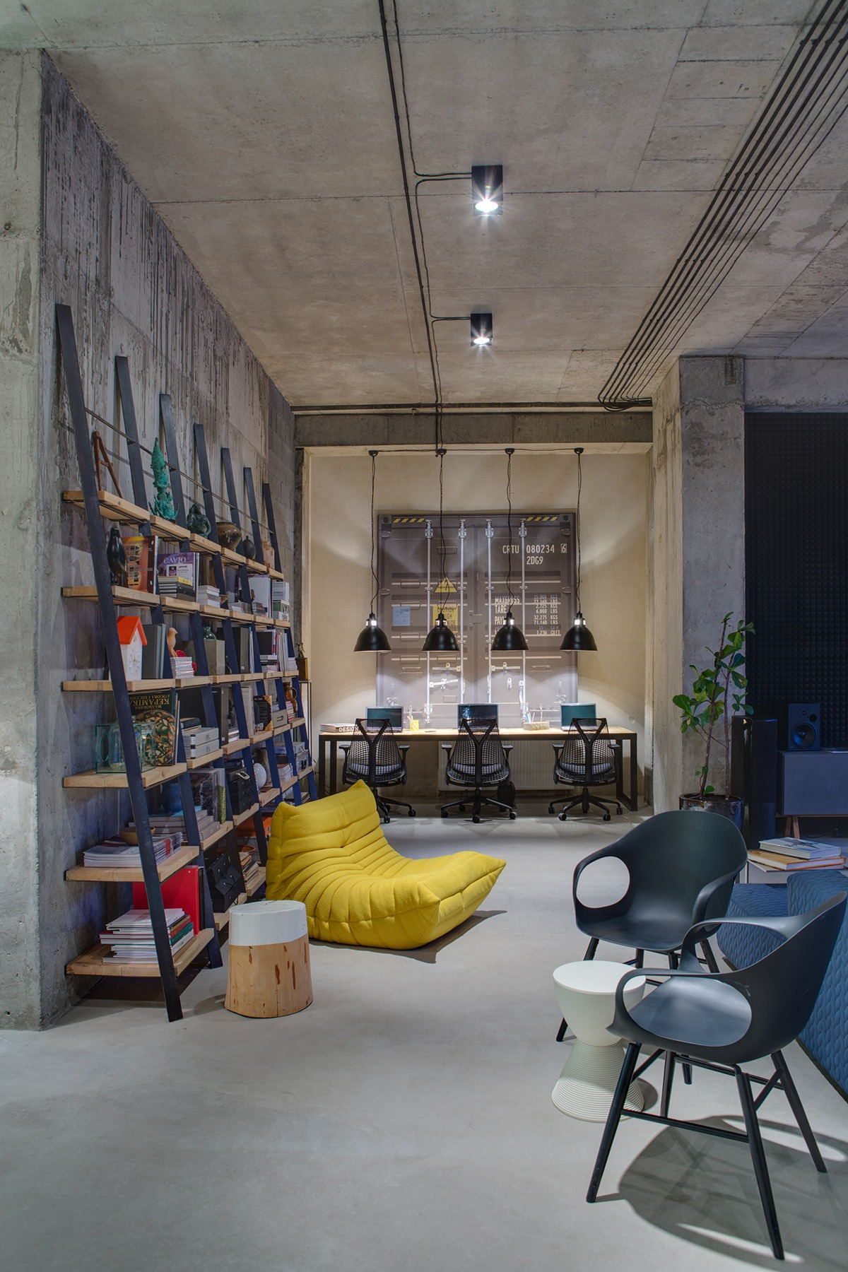 A modern office space that looks like an urban loft for Best industrial design companies