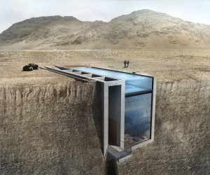The house does not protrude from the ground, with the upper portion lying flush with the surrounding dirt. Instead, the home's volume is set inside the earth with glass and water covering the exposed spaces.