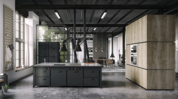 In this industrial style loft, the kitchen fits in with slate grey cabinetry and concrete flooring.