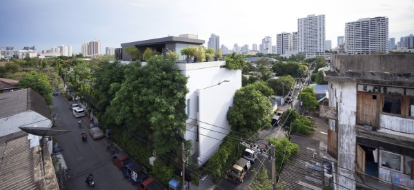 In the third space, we see what can only be an example of true Thai luxury. Multiple levels tower over the nearby town with wood slat overhangs that allow for air to flow easily while still offering shade. The wood paneled exterior is particularly beautiful while an infinity edge pool just begs to be dove into. The interior, again, is made up of deep, rich wood as well as creative lighting fixtures  and beautiful, polished reclaimed wood countertops.