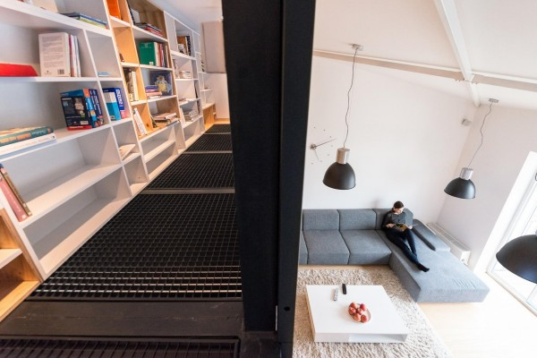 The mezzanine with bookshelves takes advantage of the tall ceilings and even includes a reading area. While some spaces might tuck a bed in this area, that wouldn't exactly be family friendly.