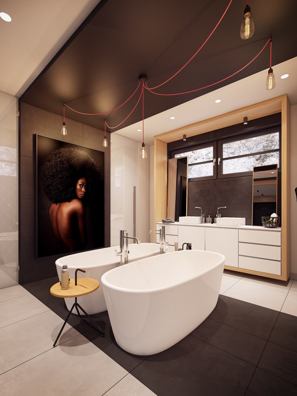 In the oversized bathroom is where the magic of this home really takes flight. Double sinks are commonplace, but not many homeowners are able to indulge in double baths. This pair of twin soaking tubs is the ultimate in luxury seduction. Lightbulbs hang from rid wiring and another portrait looks on.