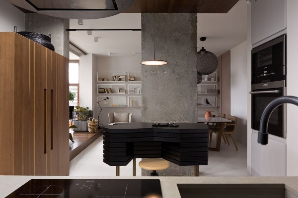 In this next space, the studio feels incredibly spacious and interesting due to the sliding doors and concrete columns that separate the different living spaces. The open floor plan coupled with the concrete accents gives the apartment a stunning modern feel, perfect for a young urban woman.