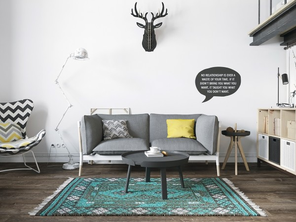 The living room space with its vaulted ceilings may feel a bit sparse to those who would look for an overstuffed sectional or formal dining room. In an apartment suited for a young couple, a simple grey loveseat does the trick. It is also the introduction the color palette that threads its way through the rest of the apartment: stark white walls, dark wood floors, and the occasional splash of yellow or teal. It's very modern and trendy without feeling overdone.