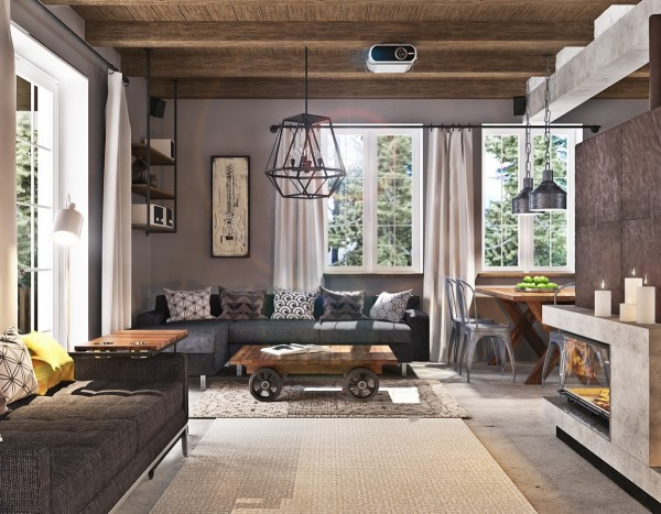 This two story home and former industrial space has been turned into a warm and inviting home. Concrete floors contrast with deep colored finished wood. Exposed ceiling beams and white brick give the industrial space a homey feel while a basement screening room is the perfect amount of dark but still includes an amazing fireplace for atmosphere.