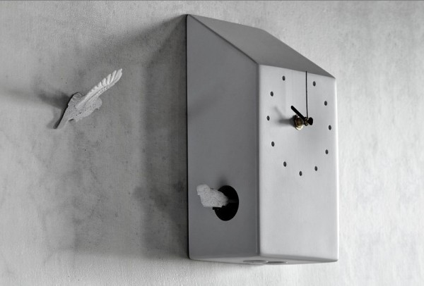 This creative cuckoo clock has two birds actually meeting on the hour.