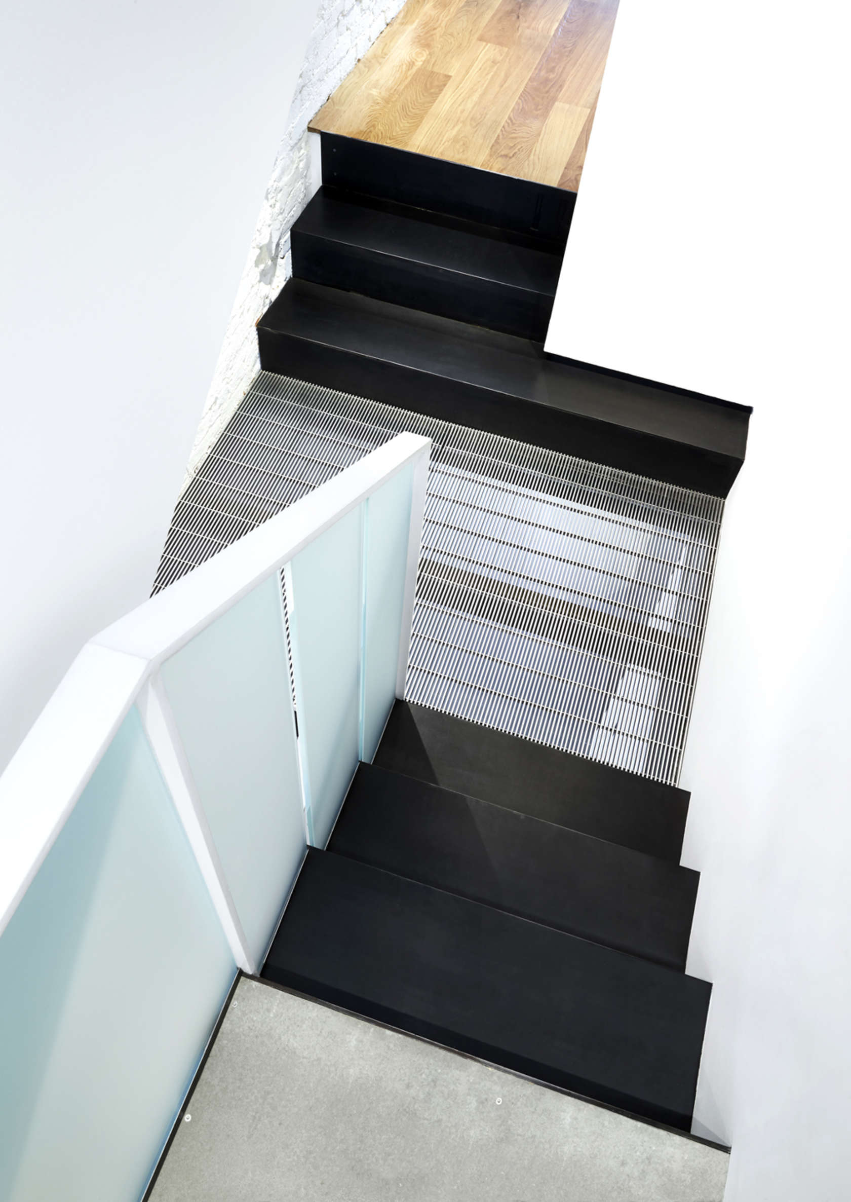 Black Industrial Stairs - A modern row house for a fun couple with a love of cooking