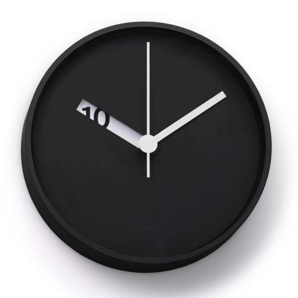 the extra normal wall clock has an extra clever design with laser cut