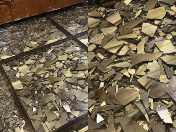 The floor is a particularly interesting exercise in layers with broken mirror fragments layered underneath a clear, smooth finish.