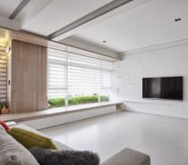 The space is designed linearly, such that the living room shares one wall with one bedroom, while that bedroom shares one wall with the second bedroom. Two long and narrow hallways on either side of the open rooms connect each separate space. That makes this home an ideal design for either a couple with guests who come frequently, or perhaps who are caring for an aging parent.