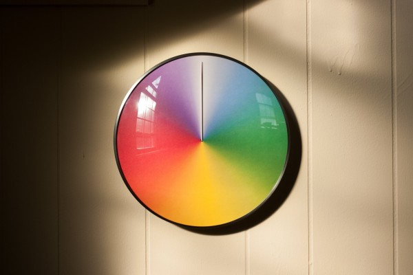 ThePresent clock is no regular clock. In addition to its lovely gradient rainbow colors, the clock actually moves annually, with 12 o'clock representing the winter solstice and 6 o'clock representing the summer solstice.