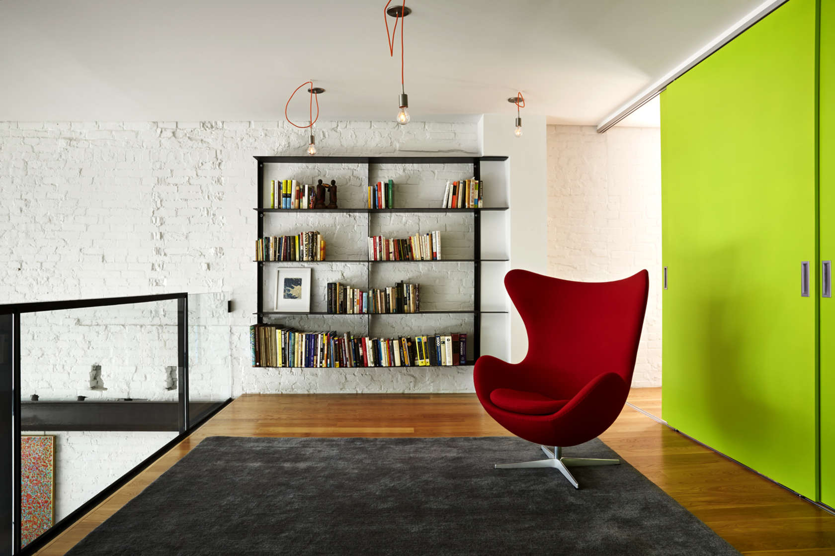Red Egg Chair - A modern row house for a fun couple with a love of cooking