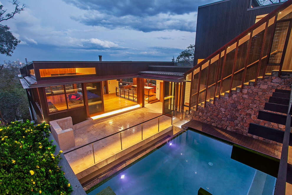 Gorgeous use of wood takes this mansion to the next level for 2 story house with pool