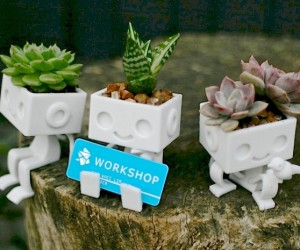 These adorable 3D printed tiny robot planters are sure to bring a smile to any face. One is even shaped perfectly for welcoming guests with a business card.