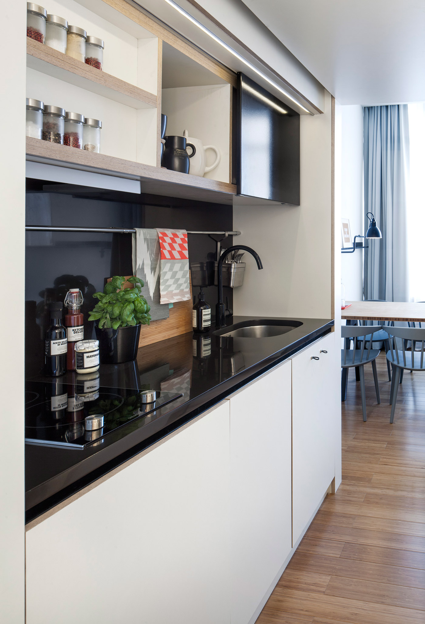 Black Kitchen Countertops - 4 awesome small studio apartments with lofted beds