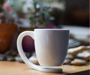 Coffee Mug With Coaster: No need for a separate coaster with this clever mug design that allows the cup to float above the surface of the table.