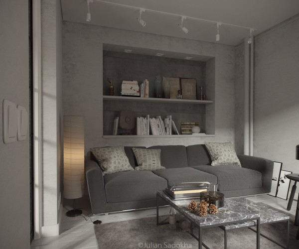 The apartment is ideal for a single person who travels and spends plenty of time outside of the home but also likes to occasionally stay in and entertain. It consists of three separate spaces: a living area, a bedroom, and an open kitchen and dining area. Up first is the living room and our first glimpse of that cool gray color palette. The soft neutral sofa folds out to easily accommodate guests while a few carefully placed furnishings serve their purpose without crowding the space.