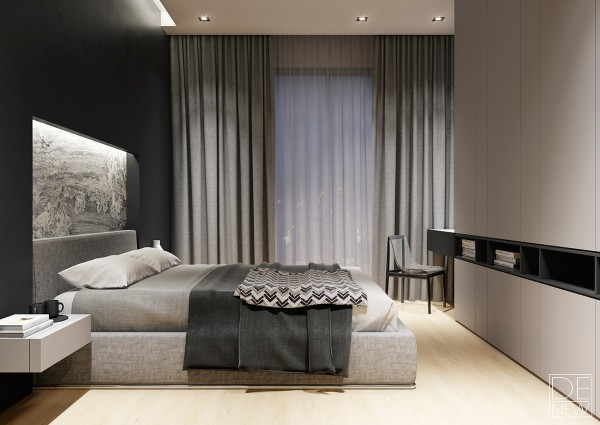 Recessed stone creates a vertical extension of the strongly woven headboard fabric. White cantilever side tables against a satin black wall serve as a sort of visual inverse to the black shelves and white cabinets on the right.