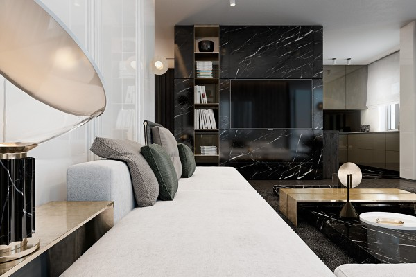 Created by Yurov Design for a young couple with an appreciation for minimalist modern style, this Kiev apartment offers a panoramic view of the city wrapped in interior luxury. This one features a monochromatic black color scheme coupled with bright brass accents, and furniture from a range of famous and up-and-coming designers.