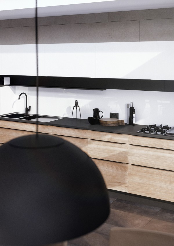 Strong lines define the kitchen. Matte black details enhance the linear effect, only broken by the curve of the faucet and lamps. These variations give the space a more natural and lively aesthetic.