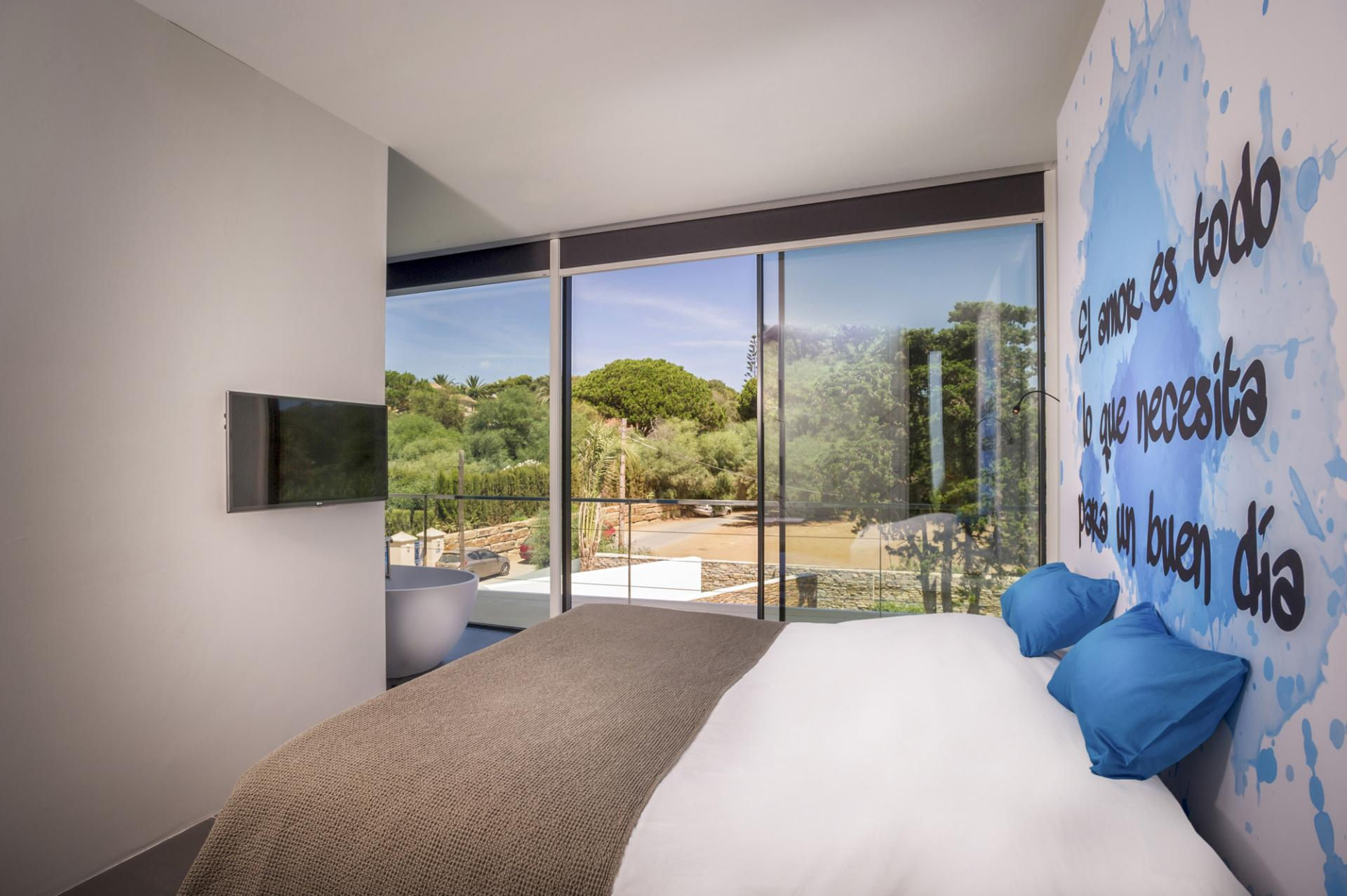 Blue Spanish Bedroom - A cool beachfront villa with geometric architecture