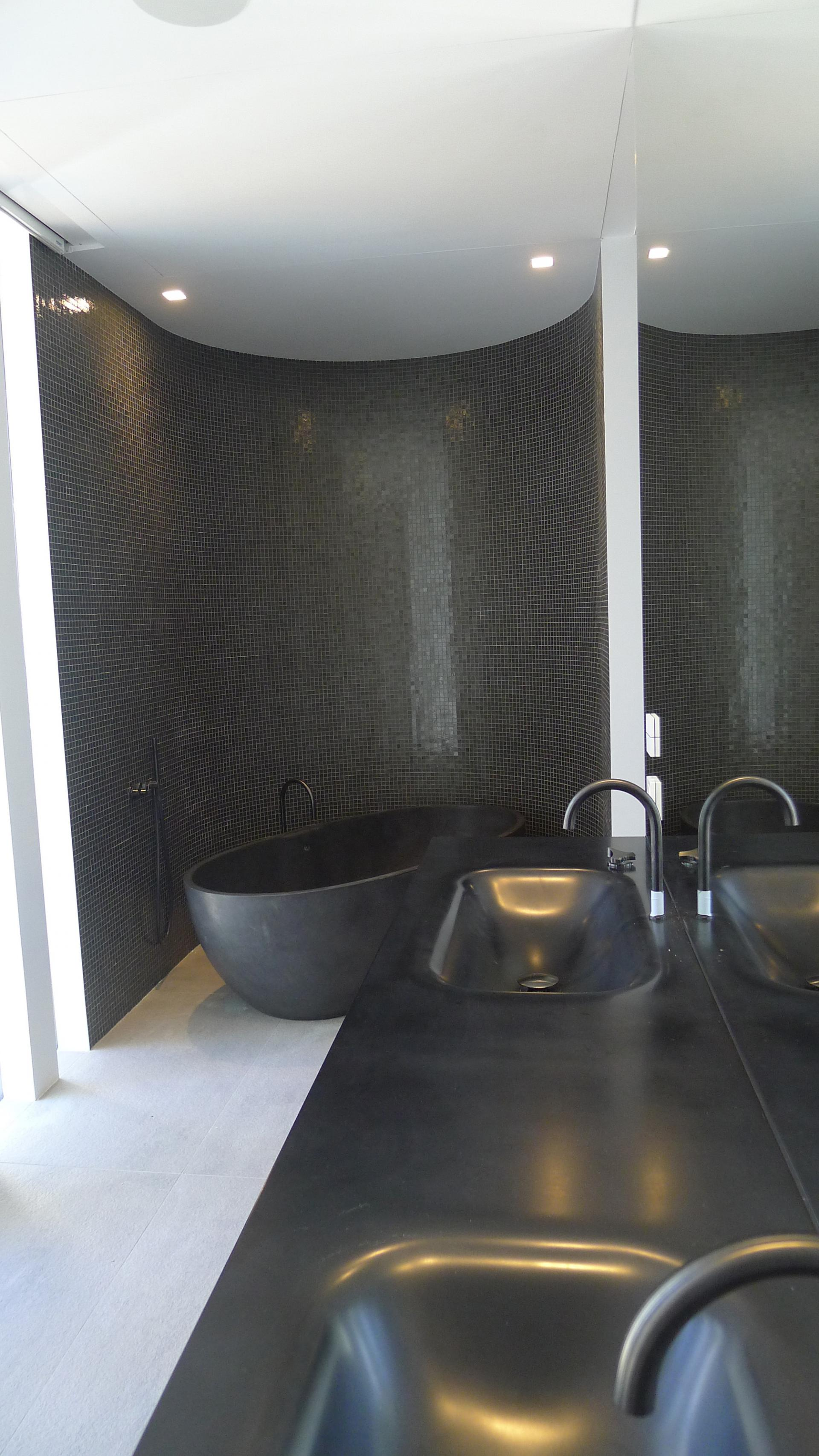 Charcoal Bathroom Ideas - A cool beachfront villa with geometric architecture
