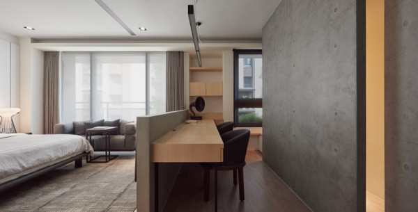 A smart mid-height divider separates the office from the rest of the master bedroom. The matte black accent wall contributes a comfortable backdrop sure to absorb the light in the early weekend hours when busy parents want to sleep in.