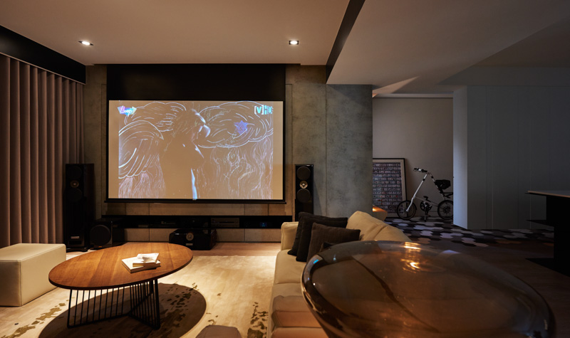 Designer Theatre Room - A stylish family apartment from made go design