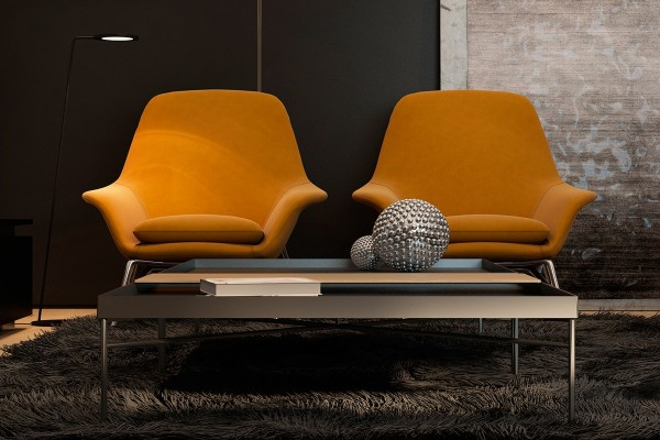 Prince armchairs by Rodolfo Dordoni offer the only true accent color in the apartment, a vibrant splash of orange.
