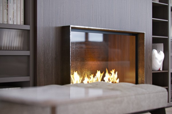 glass and wood fireplace