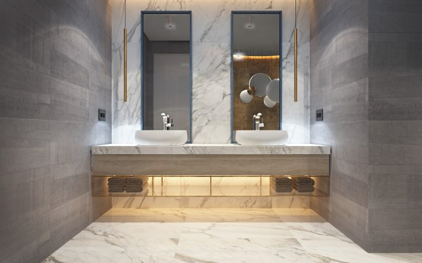 While the rest of the apartment uses fine materials modestly, the bathroom embraces its opulence with conviction. Marble floor and backsplash are sandwiched between bold gray tiles, with brass pendants and golden cove lighting to give a warm and rich appeal.