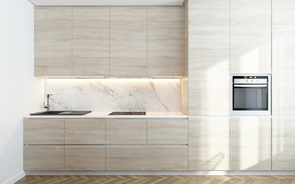 """Light wood cabinets frame a modern marble backsplash in the kitchen. Like in the other rooms, using marble so sparingly seems to heighten its impact on the overall aesthetic of the home. Like the brass, it's luxurious but not too """"showy""""."""