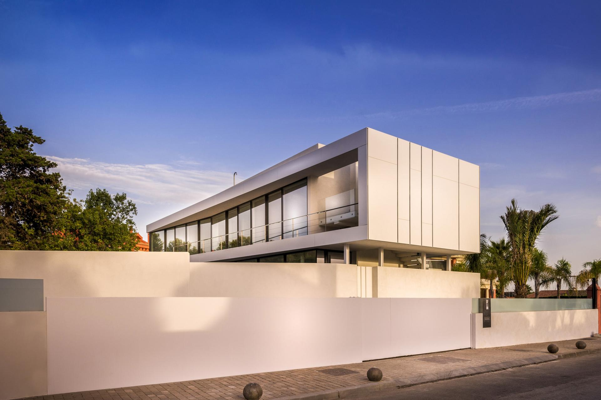 Modern White Exterior - A cool beachfront villa with geometric architecture