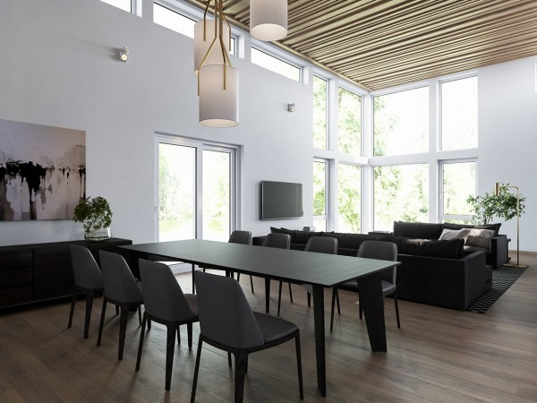 The streamlined dining room takes advantage of the same gray-on-gray theme as the living room. Even though the furniture is dark, if offers a view drenched in sunlight – thanks, in part, to the row of windows bordering the double height ceiling.