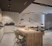 A dark drop ceiling defines the kitchen space – here, wood furniture takes the spotlight with a large slab table and matching cabinetry.