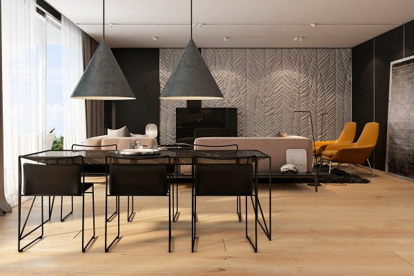 The dining room is slightly smoother, centering on a wire frame dining table with a unique trapezoid marble top. Perfectly coordinated chairs seat six. Of course, the most eye-catching part of this arrangement must be the oversized pendant lamps by Swedish architecture firm Claesson Koivisto Rune. They're relatively thin and light, but the rugged texture makes them look heavy and substantial.