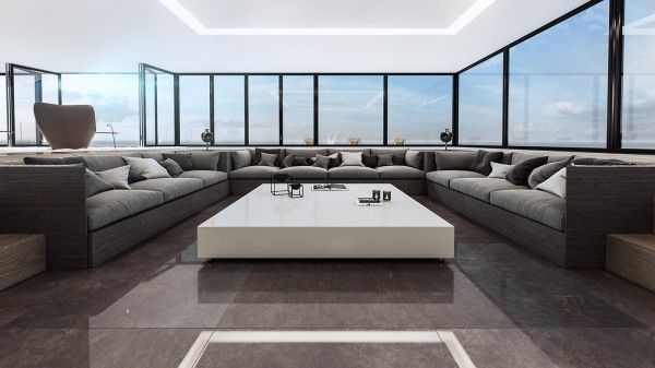 The seating area is recessed into the floor and only accessible by a series of steps on either side. A spacious sectional sofa allows people sitting on either side to get a gorgeous view out the windows, with the middle section offering the best angle for watching television. Recessed lighting frames the arrangement and keeps it bright.