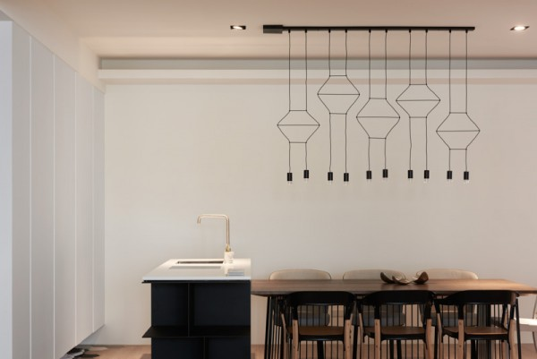 Wireflow lamps by Arik Levy  create a stunning silhouette against the blank wall in the background.