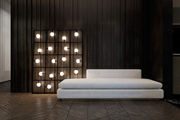 Extra space near the entrance gains a functional purpose with the addition of a waiting sofa. The gorgeously framed Squares lamp from Areti draws immediate attention and beckons visitors to take a seat.
