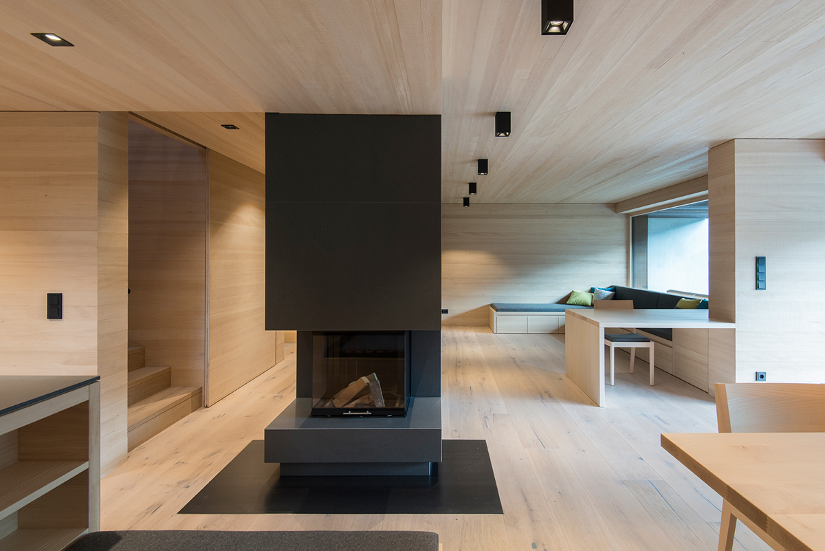 4 sleek interiors where wood takes center stage for Indoor design