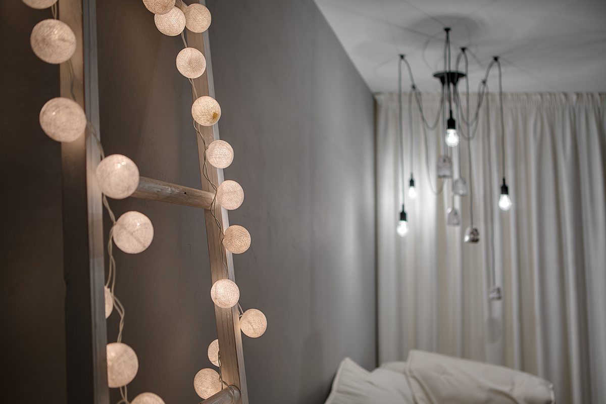 Glowing Sphere String Lights - A bright white home with organic details