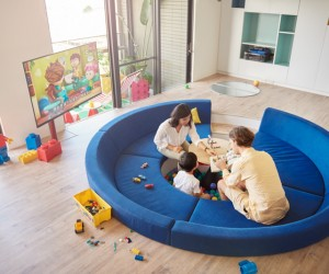 In other homes, the television would serve as the primary source of entertainment… but any young kid would surely find the ball pit to be the main attraction in this fun-filled design.