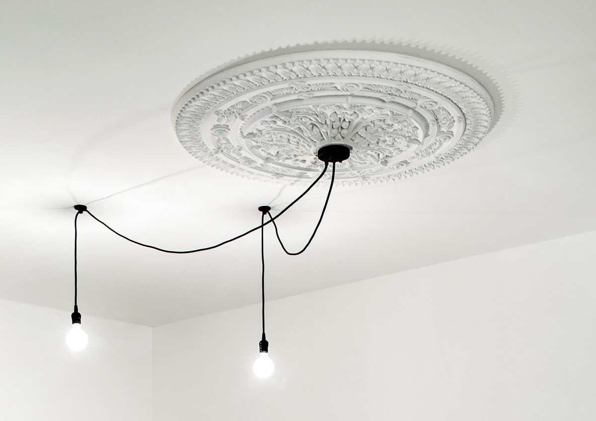 Ornate White Ceiling Medallion - A bright white home with organic details