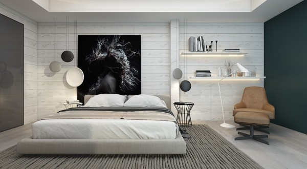 This artistic monochromatic room uses subtle white-painted panels as a backdrop to the stunning portrait on the wall behind the bed. A striking, textural rug draws the eye toward the artwork to maximize its position as the focal point of the room. The singular brown chair balances the distribution of visual weight.