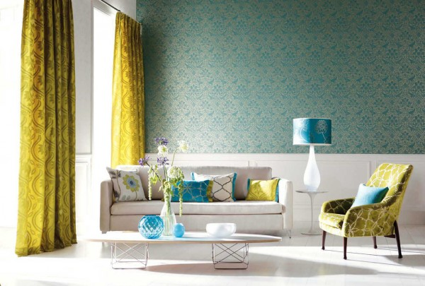 Loose and flowing patterns on the curtains contrast nicely with the tight lacelike print on the wall. Of course, bright peacock blue and rich yellow create a lovely drama of contrast as well.